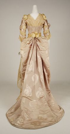 Evening dress (rear view) House of Worth (French, 1858–1956) Designer: Jean-Philippe Worth (French, 1856–1926) Date: 1887–89 Culture: French Medium: silk Dimensions: Length at CB (a): 9 1/4 in. (23.5 cm) Length at CB (b): 60 in. (152.4 cm) Credit Line: Gift of Orme Wilson and R. Thornton Wilson, in memory of their mother, Mrs. Caroline Schermerhorn Astor Wilson, 1949 Accession Number: 49.3.24a–e