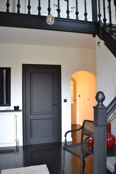 Black Interior Doors - Dramatic Or Conventional? Black Interior Doors - Dramatic Or Conventional? When you need a truly dramatic, dramatic look, nothing is more dramatic than the use of black interior doors. Black doors give you the kind of feel that . Dark Interior Doors, Black Trim Interior, Interior Door Colors, Dark Doors, The Doors, Interior Design, Design Room, Hallway Colours, Hallway Colour Schemes