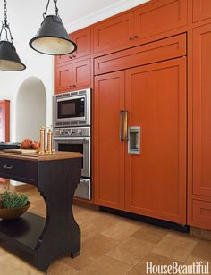Custom pulls in unlacquered bronze have the right heft for the 48-inch Sub-Zero refrigerator doors. Microwave, oven, and warming drawer by Thermador.