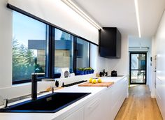 This home (and kitchen) is inspired  by a minimalist design and black and white decor