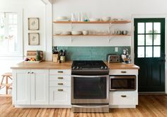 Love the open shelves! Goodbye Brooklyn, Hello Savannah: A Scandinavian-Meets-Craftsman Style Bungalow Renovation — House Tour Beadboard Kitchen, Upper Kitchen Cabinets, Open Kitchen Shelves, Kitchen Cabinet Styles, Home Kitchens, Bungalow Renovation, Kitchen Renovation, Kitchen Design, Timeless Kitchen