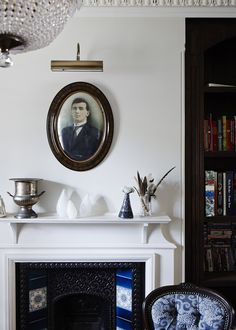 Victorian fireplace vignette with glass sculptures, found feathers, family portrait, and silver urn // dining rooms