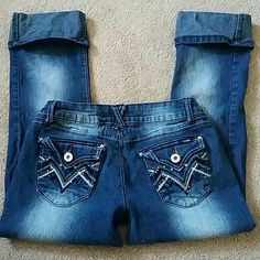 SALE - - Angels jeans Size 5 crops Size 5 blue Jean crops embellished with black and silver thread and gems on back pockets-57% ramie, 24% cotton, 17% polyester, 2% spandex. Some of the gems have came off in wash but still some there, not noticeable =)   I LOVE OFFERS! Jeans Ankle & Cropped