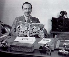 Walt Disney with a Mickey Mouse Comic Book