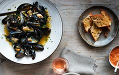 This pot of Provençal mussels is bathed in a bouillabaisse-style broth with saffron, tomato, and herbs.