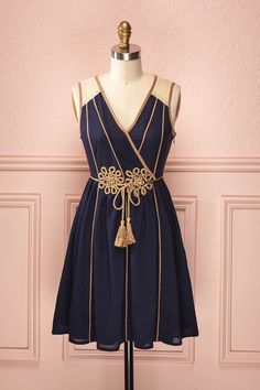 Odyssée - Navy blue dress with golden accents, belt, bow and tassels, and cream lace