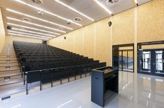 "This lecture hall building in Germany achieves a creative and visually appealing design on a limited budget. ""the almost square building contains two lecture halls with 479 and 288 seats. r"" The choice of seating in the hall stood out for me. Flur Design, Hall Design, Commercial Interior Design, Commercial Interiors, Church Architecture, Interior Architecture, Rimmel, Wood Facade, Lecture Theatre"