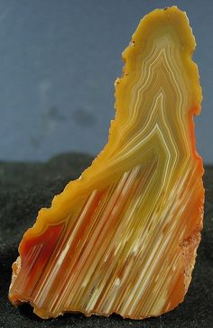 Queensland agate. Agate is the banded form of the mineral Chalcedony, which is a microcrystalline variety of Quartz. Agate is the most varied and popular type of Chalcedony, having many varieties on its own. Although the pattern on every Agate is unique, the locality of an Agate will provide resemblances in banding style and color, thus lending many Agates with a geographic prefix.