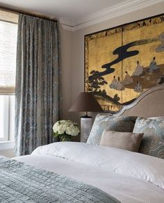 beautiful bedroom made so by installing a Chinese silk screen behind the headboard. The designer proves you don't always need a mirror to reflect light.
