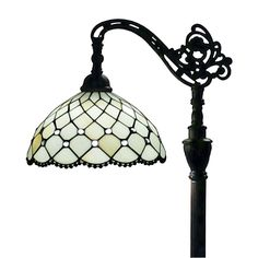 Exquisite Amora Tiffany-style decorative lamp features a floral pattern formed by carefully placed stained glass mounted in metal frame. A piece that will surely add distinguished and classic style.