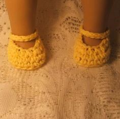 Love the doll shoes on this pattern. I would add a small corchet flower or button in the center of each shoe.