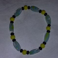Mixed glass bead - turquoise,  yellow, black - bracelet - stretchy by BritkneesBootique on Etsy