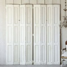"""Charming pair of antique inside shutters. Finished in cream with bits of distress at the edges, these will bring a bright atmosphere to any room. These would make excellent room dividers, dressing screens or wall art. Each shutter measures 20"""" in width. Get For More Details Click Here www.thebellacotta..."""
