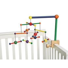 Classic wood mobile with bright primary and secondary colours. Love this design!