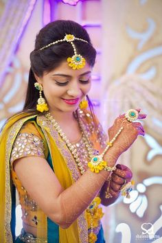 Bridal Outfits and Bridal Jewelry for Haldi Ceremony. Outfits and adornments the bride, groom and the relatives wear for the Haldi ceremony Flower Jewellery For Mehndi, Gold Jewellery, Leather Jewelry, Jewlery, Accessories Jewellery, Dainty Jewelry, Jewellery Designs, Trendy Jewelry, Handmade Jewellery