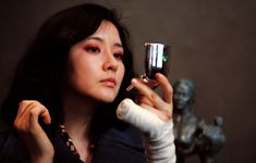 "Guem-Ja Lee from Lady Vengeance (2005) | Guem-Ja Lee is the proof that you ""can't judge a book by its cover"".  In few words, she's as beautiful as she's deadly. What's her story? Well, she was imprisoned for a crime she didn't commit. Guess what she wants once she gets out? She wants to get the ""motherfucker"" that did it."