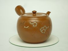 Japanese antique teapot with plum and warber.