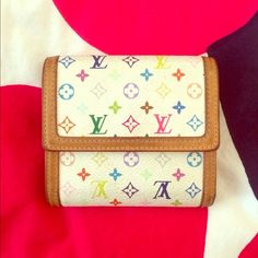 Louis Vuitton white multicolor wallet Double flap, definitely used in its glory days but still v good condition! Any stains on the leather are pictured Louis Vuitton Bags Wallets