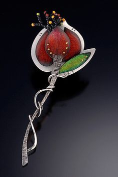 Brooch | Deb Karash.  Sterling silver; Deb developed her own thirty step metal colorizing process. Multiple layers of Prismacolor pencils create a unique palette of hue and texture. || debkarash.wordpre...