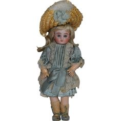 French Bisque Figure C Steiner Doll with Trunk and Wardrobe from joan-lynetteantiquedolls on Ruby Lane