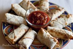 A spicy chicken, black bean and cheese filling all wrapped up in a thin crispy egg roll wrapper. A delicious fusion of Southwest and Asian cuisines that is baked and not fried.