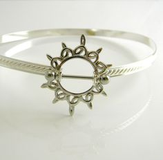 Celtic Sun Sterling Silver & Stainless Steel Slave Collar will properly fit a 12 1/8th inch neck.