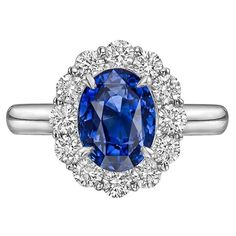 Sapphire Diamond Platinum Cluster Ring | From a unique collection of vintage cluster rings at https://www.1stdibs.com/jewelry/rings/cluster-rings/