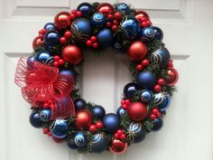 Patterned blue and gold balls with reds and cranberries. Also quite elegant!