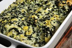 You just throw your chicken into a baking dish, then mix up your spinach artichoke topping and pour it on top. Bake it and then watch it disappear. How simple is that?