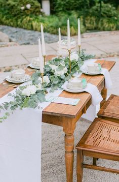 Looking for eucalyptus ideas? Have you tried Florals for Less? Artificial greenery or artificial silver dollar eucalyptus? Florals for Less is the internet's leading provider of fake artificial flowers and greenery for your wedding, baby shower and generic decor needs.  Free worldwide shipping, incredible customer service, hassle free returns. This is a gorgeous display of a long rectangular harvest table with a white runner and simple greenery with candles to make a romantic outdoor wedding.