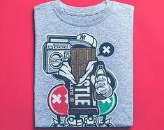 View Surf Shirts by BuyVintageShirts on Etsy Skater Shirts, Good Birthday Presents, Surf Shirt, T Shorts, Hip Hop Outfits, Street Art, Vintage Shirts, Tshirts Online, Graffiti