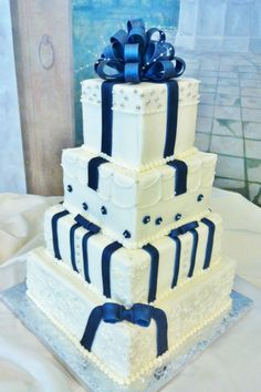 Buttercream iced tiers with gumpaste bow