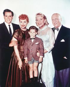 """During the second season of """"I Love Lucy,"""" Lucy and Ricky have a son named Ricky Ricardo, Jr., whom they call Little Ricky. In real life, the on-screen birth was timed to coincide with Ball's real-life delivery of her son Desi Arnaz Jr. Keith Thibodeaux, the actor who played Little Ricky, grew up in real-time on the show, unlike other shows, which quickly advance the age of a child by getting a new actor. The main cast is pictured here in a publicity photo circa 1955."""