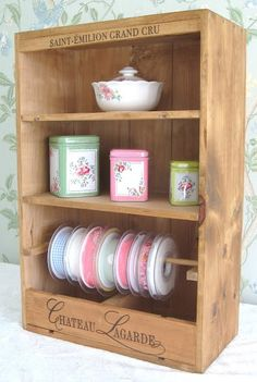Wine boxes used to make this fabulous little storage unit for ribbon and crafts