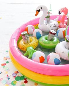 Summers not over yet! Instead of a cooler at your next party, throw all the drinks in a mini blow up pool with ice and floaties. Cutest BBQ setup ever! See our post on ohhappyday.com with @barefootwine