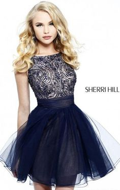 "Dress length: 17"" (Waist to hem) Shown in: Navy Go for a stunning beauty with Sherri Hill 11032. This refined evening gown showcases a scoop neckline with deep V-back. Bodice coated with heavily beaded embellishments."
