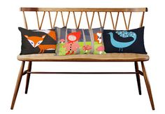 Love the simple lines of the bench and the storybookish pillows.
