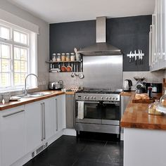 White Kitchen Units Black Worktop kitchen/diner with white units and glass table | google images