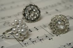 rings made from vintage buttons...now I know what to do with all the great antique buttons I have. Earings too!