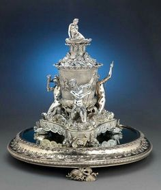 "By far the greatest silver service ever created was the ""Grand Service"" made by Rundell, Bridge and Rundell for King George IV of England. It took approximately 10 years to complete and cost an amazing £100,000 (this is about $15 million in today's money). The great majority of this service resides in Windsor Castle and is still used by the Queen.1821"