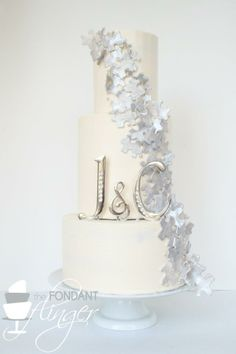 Silver and white wedding cake with puzzle pieces