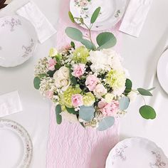 Floral centerpieces, a little lace and beautiful china plates made for the perfect tablescape! #decor #floral #centerpiece #tablescape #ideas #diy #babybrate