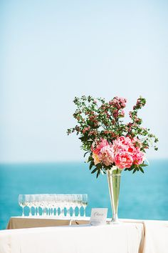 Cocktail trays on a white table with bright pink flowers