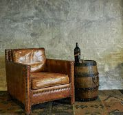How gorgeous does our Saloon Chair & Original Wine Barrel Table look against the muted tones of the concrete wall and Kilim rug.