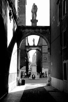 Verona: While not huge, architecturally the Piazza dei Signori is significant, with a mixture of styles, all joined by a series of arches. In the middle of the square is a statue of the writer Dante.