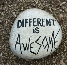 Different is awesome rock painting