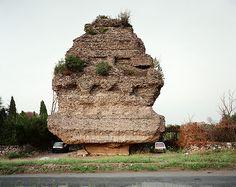 Joel Sternfeld,  Lovers parking beneath a pyramidal tomb of the second century A.D., Via Appia Antica, Rome, November 1990