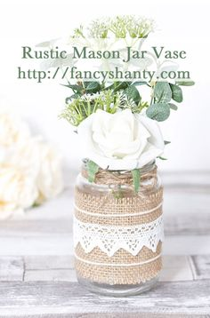Make this lovely rustic mason jar vase to create your own beautiful home décor, or add flowers for an elegant a DIY wedding centerpiece. http://fancyshanty.com/rustic-mason-jar-vase/