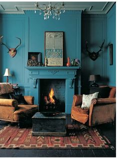 The colour of the wall, the old coffee table, chandelier, etc. This is amazing!