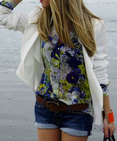 The white jacket again, even with jean shorts. Love the flowered top and of course, the bracelet!